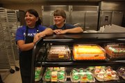 Bakers at Dillons since 1980, Julie Sutheimer, left, and Karen Strickland worked their last day at Dillons at 1740 Mass. Both bakers have jobs at other Dillons stores. 