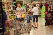 Megan Allred and her son Wyatt, both of Lawrence, were among the many shoppers hitting the aisles at Dillons, at 1740 Mass., which was closing on Saturday to make way for a new Dillons store at the same location.