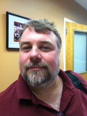 Jeff Plinsky, who teaches and coaches debate and forensics at Lawrence High School.