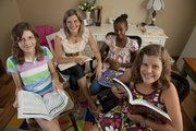 Pam Zicker, second from left, will be home-schooling her daughers, from left,  Cailyn,  12, Eyerusalem, 12, and Lydia, 11,  at home for a third year.