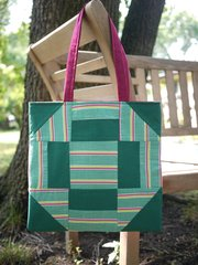 This lined bag was made with a vintage quilt block from the Lawrence Antique Mall.