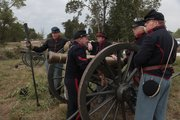 At left, Alan Van Loenen, Lawrence, and a member of the 3rd Kansas, Battery B, light artillery, with other crew members before an engagement at the Battle of Wilson's Creek 150th Anniversary Reenactment, held near Springfield, Mo., on August 12-14, 2011.