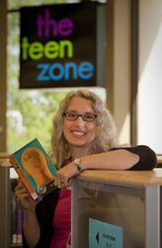 Rebecca Power is teen service librarian at the Lawrence Public Library. She says adults love young adult books almost as much as kids.