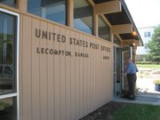 A patron goes into the U.S. Post Office in Lecompton.