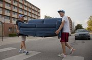 Steve Lemieux, left, and his son Max Lemieux, a sophomore at KU, both from Overland Park, move Max's couch into KU's Hashinger Hall on Friday, August 19, 2011.