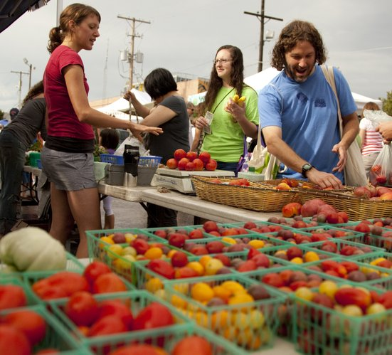 Gregory Rudnick of Lawrence weighs his options while selecting tomatoes from, Jennifer Kongs, a seller at the Avery's Produce stand, left, on Saturday, Aug. 20, 2011 at the downtown Farmer's Market. Chris Wilson, the deputy secretary with the Kansas Department of Agriculture, not pictured, was on hand to talk about the importance of farmer's markets in regards to strengthening the relationship between grower and buyer.