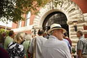 Al Kaine of Overland Park looks down Massachusetts Street as he listens to John Jewell, a retired educator, give a history lesson about Quantrill's Raid on Aug. 21, 1863, during a walking tour Saturday, Aug. 20, 2011. A couple dozen people participated in the tour which stopped by various historic buildings in the downtown area that survived the raid.