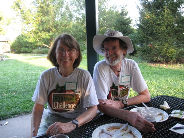 "Marcy and Al Mauler, of Lawrence, enjoy the Eat Local Challenge Community Potluck Picnic in Centennial Park. They said, ""it's been fun."" They were surprised by the variety of foods — all made with local ingredients. They were impressed with the spring rolls."