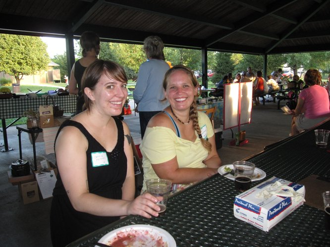 Cassie Peters, left, and Crystal Hammerschmidt, both of Lawrence, enjoy the Eat Local Challenge Community Potluck Picnic in Centennial Park. Hammerschmidt is participating in the Challenge for the first time.