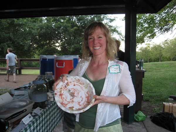 "Lynate Pettengill, Lawrence, won the ""best dish"" contest at the Eat Local Challenge Community Potluck Picnic on Sunday, Aug. 21, 2011, in Centennial Park. She brought rhubarb pie that didn't last long — she's holding the empty dish. She used local rhubarb and her grandma's recipe. The winner was decided by those who attended the picnic."