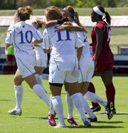 Kansas forward Jamie Fletcher receives a congratulatory hug from a teammate following Fletcher's first half goal during Kansas' soccer match against Arkansas Sunday, August 21, 2011.