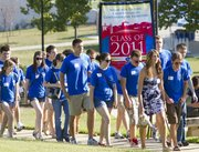 Mount Oread Scholars make their way up Campanile Hill on Sunday, August 21, 2011. More than 200 scholars made the walk up the hill which symbolizes the beginning of their college careers.