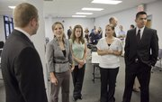 Some of the 13 new Lawrence police recruits visit with city and police department officials after they were sworn in during a ceremony at the Investigations and Training Center on Tuesday, August 23, 2011. From left are Chris Schweer, Lauren Link, Sheri Stites, Meagan Horvath and Dean Kemppainen.