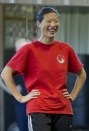 Chen Huixian stops for a moment to share a laugh with her class during a beginner tai chi class held at Premier Martial Arts Academy, 3201 Clinton Parkway. The classes, which began in May, are held twice a month, generally every other Sunday.