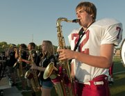 Lawrence High school junior Jacob Carnahan performed double duties during the Lawrence High school fall sports jamboree Wednesday at LHS. He opened with the Marching Lions band playing saxophone before he joined the varsity football team as a lineman during a scrimmage.