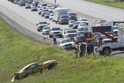 A Ford Mustang is pulled from a ditch along the Kansas Turnpike on Thursday, Aug. 25, 2011. Emergency crews were investigating an accident that involved two cars in the eastbound lane. Traffic was stopped just west of East 600 Road to allow a LifeStar helicopter to land on the road.