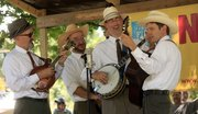 Members of the Midday Ramblers of Lawrence, from left, Kory Willis, Paul Schmidt, Leo Posch and Mike Horan, perform to a crowd during last year's Kansas State Fiddling and Picking Championships in South Park. This year's competition starts on Sunday at noon.