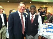 How&#39;s that for charisma? KU men&#39;s basketball coach Bill Self can work a room, but J&#39;Qui Audena just may own it. &quot;You&#39;re a stud,&quot; Self told Audena, soon after the Lawrence High School senior picked up his Student Champion award during the Community Education Breakfast Aug. 26, 2011, at the Holiday Inn Lawrence.