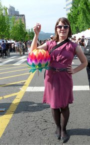 Leah Hoelscher holds a lotus lantern  she made at a Buddha's birthday celebration in May 2010 in Seoul, South Korea. Hoelscher has taught English in Seoul for nearly two years.