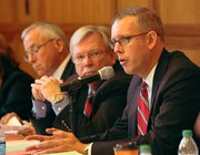 Sen. Tim Owens, center, listens to Rep. Paul Davis, right, of Lawrence, give his thoughts on redistricting during a hearing at the Dole Center of Politics on Sept. 2, 2011. Local residents and officials came to the hearing to tell legislators what they wanted out of the process.