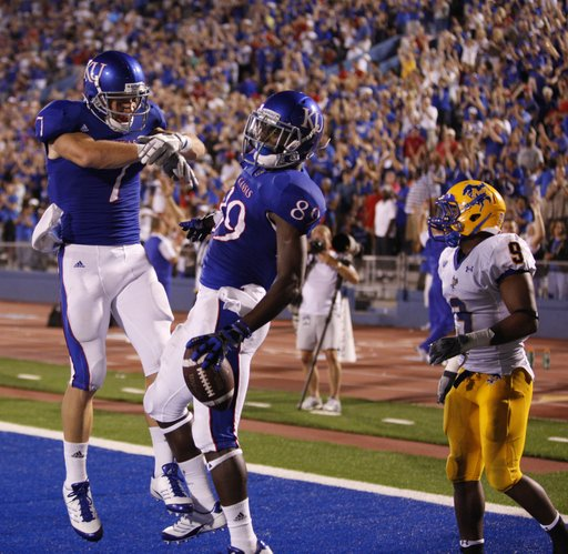 Kansas receivers Kale Pick (7) and JaCorey Shepherd bump chests after Shepherd's second touchdown of the game against McNeese State during the fourth quarter on Saturday, Sept. 3, 2011 at Kivisto Field.