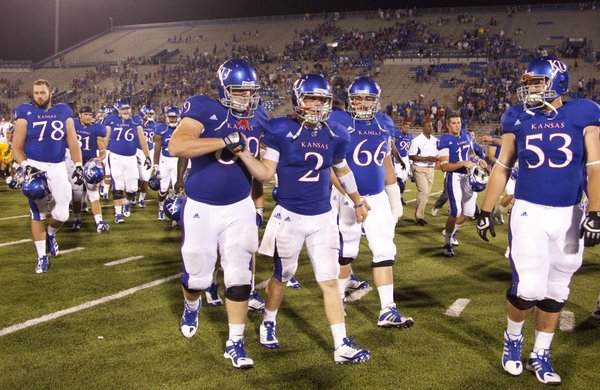 Kansas lineman Trevor Marrongelli congratulates quarterback Jordan Webb (2) after the Jayhawks' 42-24 win over McNeese State on Saturday, Sept. 3, 2011 at Kivisto Field.