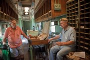 Former railroad mail clerks Eldon Denney, Springfield, Mo., left, and Herb Crawford, Osawatomie, reminisce about working in the mail car during a ride Saturday at the Railroadiana Labor Day Railfest at Midland Railway in Baldwin City, Saturday, Sept. 3. Rides continue through Monday.