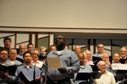 Darryl Porter, an inmate at Lansing Correctional Facility, sings a solo during a June performance of the East Hill Singers at Overland Park Church of Christ. The East Hill Singers are an all-male choir of inmates and community volunteers formed by Arts in Prison Inc. in 1998.