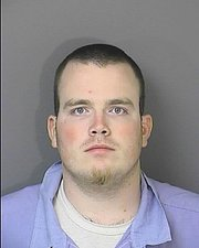 Recent prison mug shot of Jason Rose, who was convicted on three counts of manslaughter by a Douglas County jury for his involvement in the 2005 Boardwalk Apartment fire in Lawrence. Rose's case has recently been taken by the Kansas University Project for Innocence. Rose is serving a 10-year sentence, and is eligible for parole in June 2014.