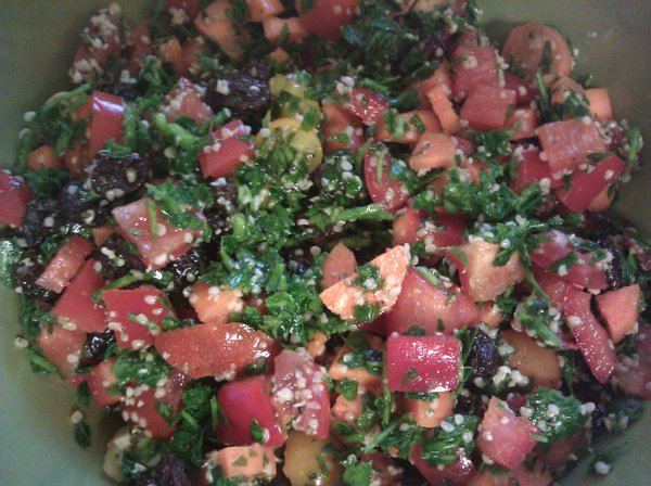 My take on tabbouleh  lots of veggies, hemp seed and raisins!