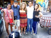 Rio trip: Lawrence residents Gary Smith, second from left, and Sarah Stern, center, and Kansas University graduate Carlos Beltran pose for a picture in Rocinha, the largest favela in Rio de Janeiro, Brazil, while photographing the impoverished gang-led community in June for a book/movie project. Also pictured are Fernanda Renilux, left, and Luciana Mota, right, Rocinha residents who hosted Beltran, Stern and Smith. Janet Cinelli submitted the photo.