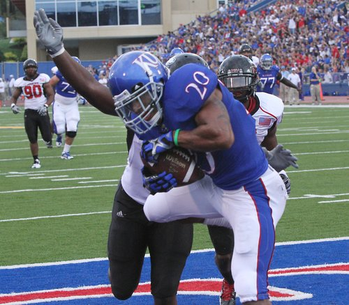 Kansas wide receiver D.J Beshears holds on to a touchdown in the first half against Northern Illinois on Saturday, Sept. 10, 2011 at Memorial Stadium.