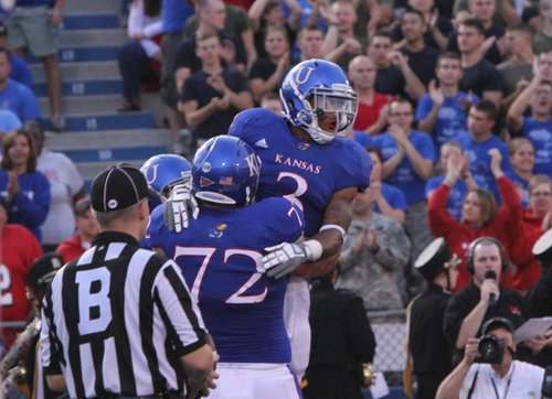 Kansas running back Darrian Miller is congratulated by Tanner Hawkinson (72) after a touchdown run late in the second quarter Saturday, Sept. 10, 2011 at Memorial Stadium.