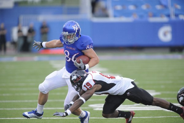 Kansas tight end Tim Biere is shoved out of bounds by Northern Illinois defender Demetrius Stone on Saturday, Sept. 10, 2011 at Memorial Stadium.