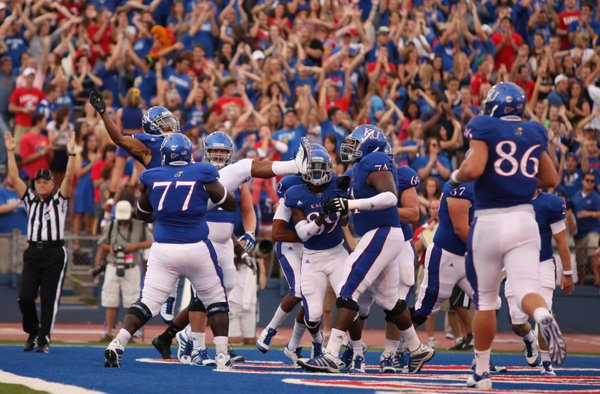The Kansas Jayhawks celebrate a touchdown by receiver D.J. Beshears during the first quarter against Northern Illinois on Saturday, Sept. 10, 2011 at Kivisto Field.