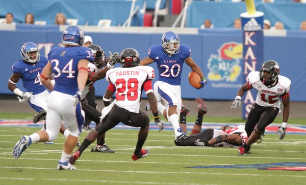 Kansas kick returner D.J. Beshears hops over a defender and cruises up the field against Northern Illinois during the first quarter on Saturday, Sept. 10, 2011 at Kivisto Field.