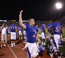 Kansas quarterback Jordan Webb motions to the Memorial Stadium crowd after connecting with receiver D.J. Beshears for a touchdown late in the fourth quarter on Saturday, Sept. 10, 2011 at Kivisto Field.