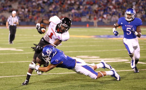 Northern Illinois receiver Martel Moore is tackled by Kansas safety Keeston Terry during the fourth quarter on Saturday, Sept. 10, 2011 at Kivisto Field.