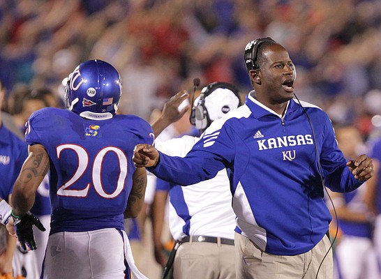 Kansas head coach Turner Gill celebrates after a touchdown against Northern Illinois during the third quarter on Saturday, Sept. 10, 2011 at Kivisto Field.