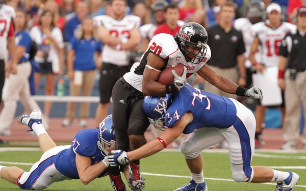 Northern Illinois kick returner Tommy Davis is brought down by Kansas special teams players Ted McNulty (87) and Huldon Tharp (34) during the first quarter on Saturday, Sept. 10, 2011 at Kivisto Field.