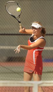 Lawrence High sophomore Zoe Schneider returns on Monday, Sept. 12, 2011.