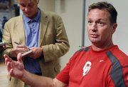 Oklahoma head coach Bob Stoops speaks during an NCAA college football news conference in Norman, Okla., on Monday, Sept. 12, 2011. A person with knowledge of the situation says Texas and Oklahoma officials met over the weekend amid speculation that the Sooners are considering leaving the Big 12.