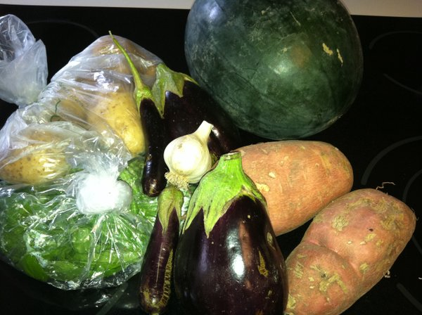 Our pickup on Sept. 12 from Rolling Prairie. Eggplant, potatoes, sweet potatoes, basil, garlic and melon.