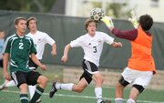 Free State senior midfielder Zach Thompson (3) races to the ball with Shawnee Mission South junior midfielder Adam Alfaro (2) on Tuesday, Sept. 13, 2011 at Free State High School.