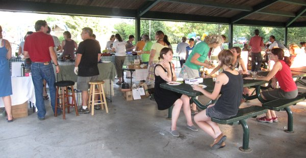 The Eat Local Challenge Community Potluck Picnic drew 75 people on Sunday, Aug. 21, 2011, at Centennial Park. Everyone brought dishes made with local ingredients.