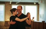 Lawrence resident Doug Nickel dances with Brigitta Wade, Lawrence, during a meeting of the Lawrence Tango Club in the gallery space at Signs of Life, 722 Mass., on Monday, May 16, 2011.
