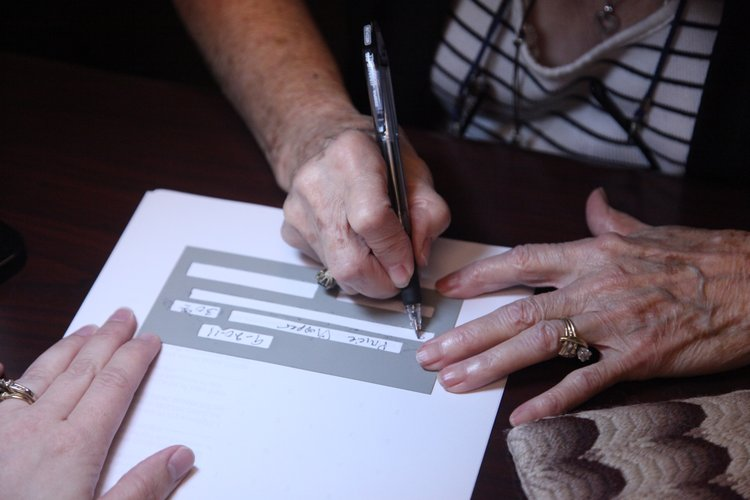 eye doctor describes alphapointe as haven for people who are blind  nancy baker of prairie village tries out a 20 20 pen and check writing