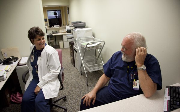 Dr. Ronald Stephens, medical director of The Oncology Center at Lawrence Memorial Hospital, laughs with registered nurse Stephanie Norris on Thursday, Sept. 15, 2011. LMH marked the 10-year anniversary of The Oncology Center with a celebration on Sept. 20, 2011.