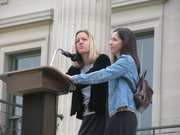 Tamara Werth, left, and Crystal McComas, both of Lawrence, on Friday speak at rally on the south steps of the Capitol.