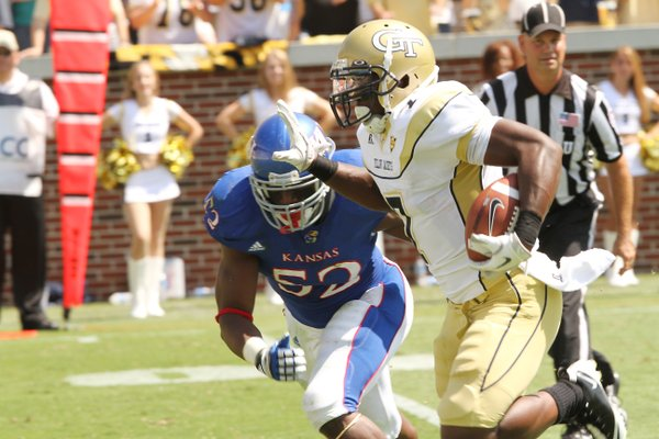 Georgia Tech running back Orwin Smith runs past KU's Steven Johnson on Saturday, Sept. 17, 2011 in Atlanta.